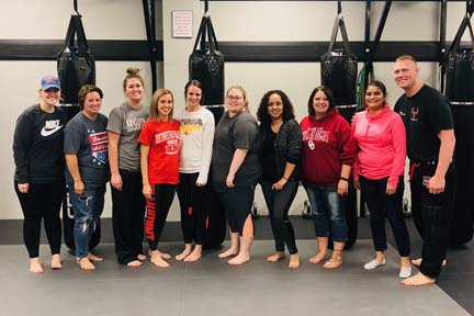 "Students from Northwestern Oklahoma State University's Woodward campus participated in the Social Workers Association of Tomorrow (SWAT) ""Self-Defense Night"" at the RYSE Academy of Mixed Martial Arts in Woodward to learn more about self-defense techniques."