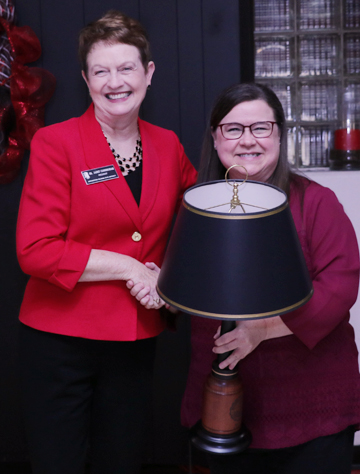 Valarie Case receiving lamp from Dr. Cunningham